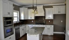 backsplashes for white kitchen cabinets glamorous kitchen backsplash white cabinets black countertop