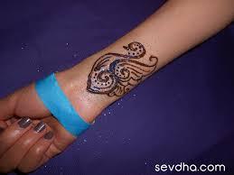 sevdha henna tattoos swan wrist orlando artist sevdha back hand