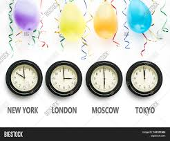 new years streamers four wall clocks indicating time zones for new york london