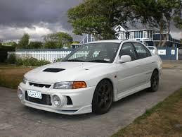 purple mitsubishi lancer lancer evolution iv