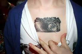 picture of interesting 3d camera tattoo on the ankle