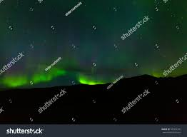 when are the northern lights visible in iceland impressive green aurora borealis northern lights stock photo