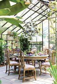 a glass greenhouse turned into a eclectic dining room just lovely
