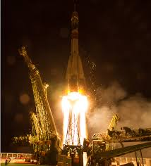 russian u s italian crew trio arrives at iss after express soyuz