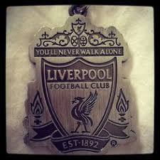 a tattoo featuring the emblem for the liverpool football club on