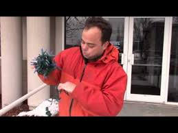 how to wrap christmas lights around a tree how to wrap christmas tree lights the professional way youtube