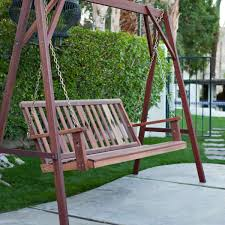 exterior traditional patio design with classic blue porch swing