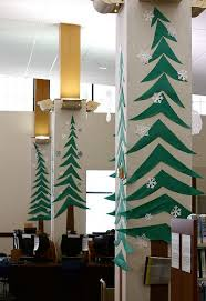Ideas For Christmas Tree Bulletin Board by Trees On Library Pillars Christmas Teaching Bulletin Boards