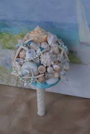 wedding bouquets with seashells starfish pearl and seashell bouquet w boutonniere set 118 00