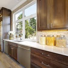 white kitchen countertops with brown cabinets light brown cabinets with white countertops page 1 line