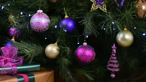 bokeh defocused lights of a festive christmas tree with jewel