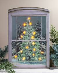 pine tree in window lighted picture