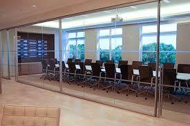 refine glazed conference room with all glass pivot doors at