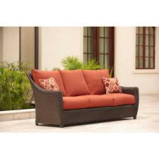 brown jordan highland patio sofa with cinnabar cushions and empire