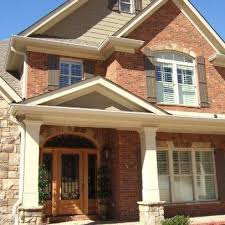 image result for red orange brick with charcoal mansard roof and