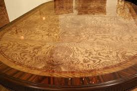 large luxurious burly ash and mahogany oval dining table
