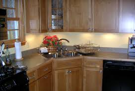 kitchen traditional l shaped teak island with monotone countertop