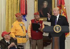while honoring native american veterans trump calls warren