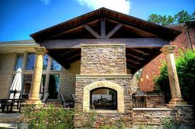 Outdoor Fireplace Houston by Grand Home Addition With Outdoor Kitchen See Through Fireplace
