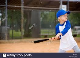 boy swinging baseball bat stock photo royalty free image
