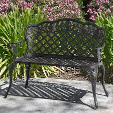 outdoor public wooden park bench w metal wrought or cast iron