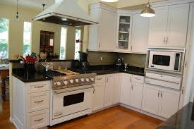 kitchen white cabinetry with panel appliance also black galaxy