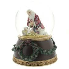 kneeling santa musical snowglobe the catholic company