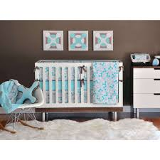 white wooden crib for baby boy with blue white floral bedding
