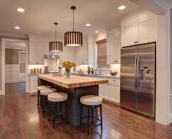 detroit white kitchen cabinets with butcher block countertops