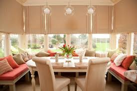 dining alcove dining room traditional with orange bench cushion