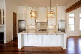 white center island with brass box lanterns transitional kitchen