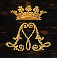 a monogram crowned by the coronet of a duke or duchess