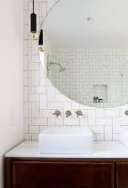 178 best bathroom renovation ideas images on pinterest bathroom herringbone pattern with subway tiles vintage credenza vanity round mirror smitten studio