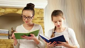 teen listening how her sister reading story girls spending time