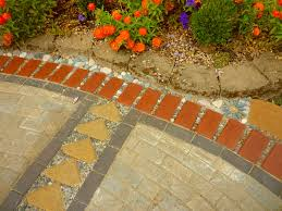 Patio Edging Stones by Wow Thats A Busy Garden Creating A Paver And Pebble Mosaic Patio