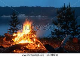 Sparks Fireplace - big night bonfire on riverbank forest stock photo 504858025