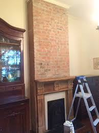 should i paint the fireplace brick and mantle the color of the wall