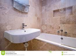 luxury bathroom with stone tiled walls stock photography image