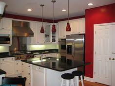 Red And Black Kitchen Cabinets by White Cabinets And Moldings Contrast Perfectly With Burgundy Or