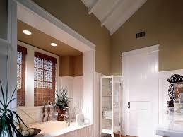 bathroom bathroom storage sloped ceiling tan walls white wood