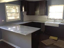 kitchen cabinet white cabinets red backsplash drawer knobs