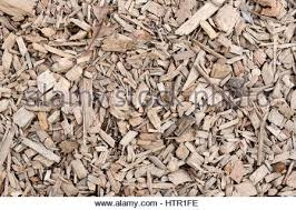abstract background of small wood pieces on carpenter table stock