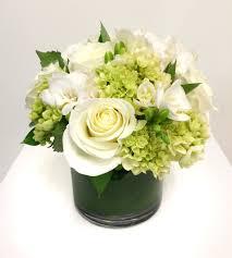 White Floral Arrangements Centerpieces by Wedding Reception Floral Arrangement Centerpiece In Gold Sphere