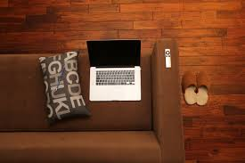 free images laptop notebook computer macbook mobile apple apple pencil wood technology wall remote loft communication living room furniture sofa pillow apartment couch home office interior design