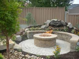 Building A Raised Patio With Retaining Wall by Concrete Grill Pad Area Circular Paver Patio With Fire Pit
