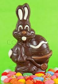 easter chocolate bunny chocolate bunny with easter egg and colorful candies on green