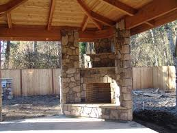 backyard patio designs with fireplace with best outdoor kitchen
