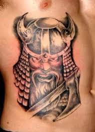 viking with ax tattoo on ribs tattoos book