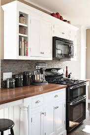 Kitchens With Black Countertops Best 25 White Kitchen Appliances Ideas On Pinterest White