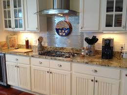 kitchen backsplash tile with dark cabinets rectangular table